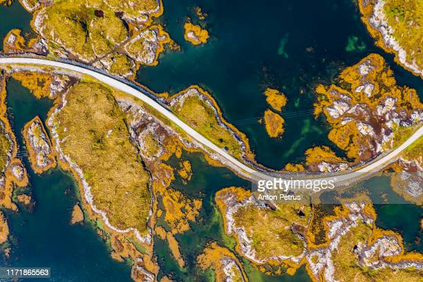 aerial view of beautiful road with bridge on the island smola, norway. - transport stock pictures, royalty-free photos & images