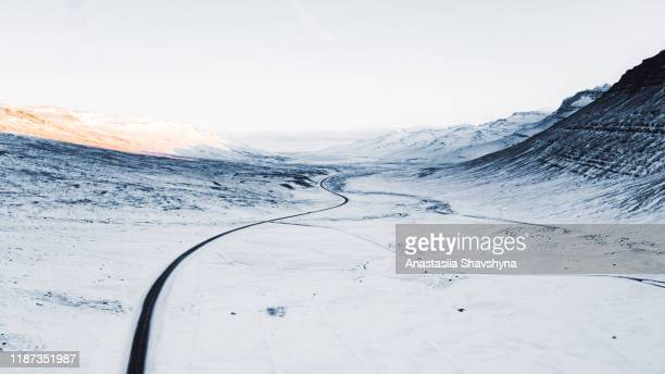 aerial view of beautiful winter road and mountains during sunset in north iceland - geologia imagens e fotografias de stock