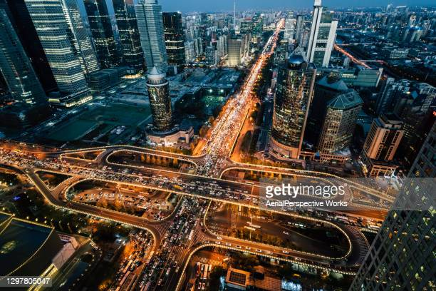 aerial view of beijing traffic and road intersection at rush hour - beijing stock pictures, royalty-free photos & images