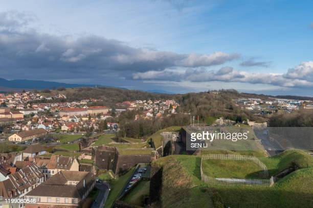 aerial view of belfort castle and the cityscapes in a sunny day - ベルフォール ストックフォトと画像