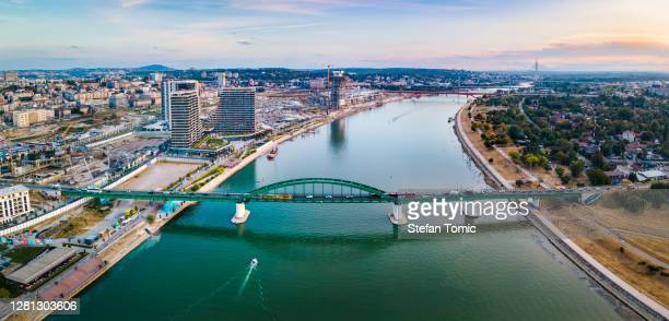 aerial view of belgrade the capital city of serbia by the sava river at sunset - serbia stock pictures, royalty-free photos & images