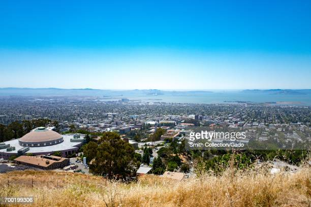 Aerial view of Berkeley California from the Berkeley Hills with University of California the city of Oakland and the San Francisco Bay Bridge visible...