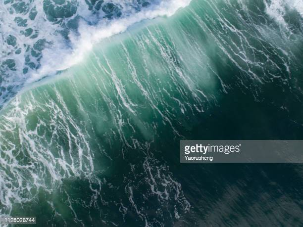 aerial view of big wave on the sea - tide stock pictures, royalty-free photos & images