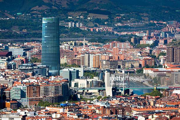 Aerial view of Bilbao Guggenheim Museum Iberdrola Tower skyscraper and Red Bridge in Basque country Spain