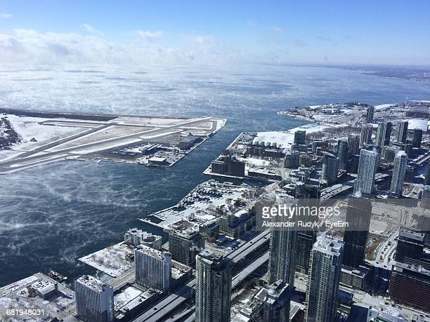 aerial view of billy bishop toronto city airport and city against sky - lake ontario stock pictures, royalty-free photos & images
