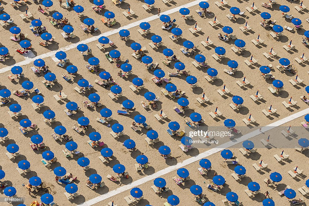 Aerial View of blue sunshades standing in rows : Stock Photo
