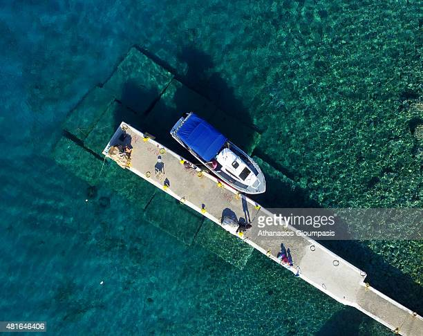 Aerial view of boat at turquoise waters at the Loutro village on July 16 2015 in Crete GreeceThe small village of Loutro nestled in a small cove and...