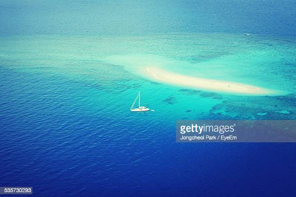 Aerial View Of Boat In Blue Sea