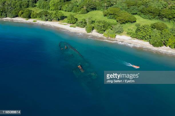 aerial view of boat in sea - solomon islands stock pictures, royalty-free photos & images