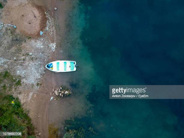 Aerial View Of Boat On Shore At Beach
