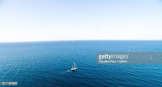 Aerial View Of Boat Sailing In Blue Sea Against Clear Sky