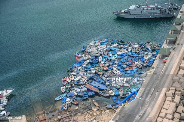 Aerial view of boats and inflatables used by migrants disembarked in recent days in Lampedusa and abandoned in the port of the island waiting to be...