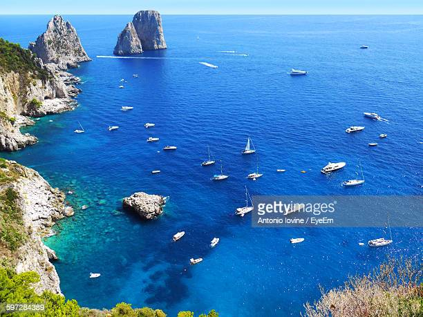 aerial view of boats in blue sea - capri stock pictures, royalty-free photos & images