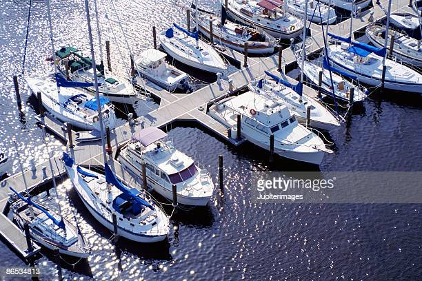 aerial view of boats in marina - marina stock photos and pictures