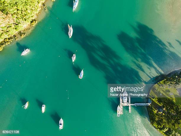 Aerial view of Boats in sea at Whangaparaoa, Auckland, New Zealand.