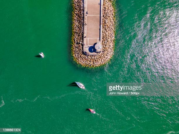 aerial view of boats in sea,s w coast path,plymouth,united kingdom,uk - nautical vessel stock pictures, royalty-free photos & images