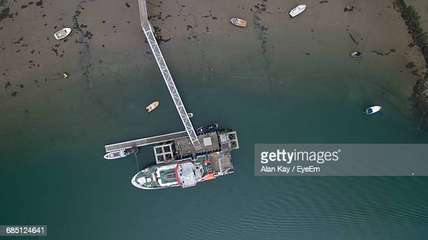 aerial view of boats moored at shore - menai bridge stock photos and pictures