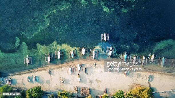 aerial view of boats moored on shore at beach - manila philippines stock pictures, royalty-free photos & images