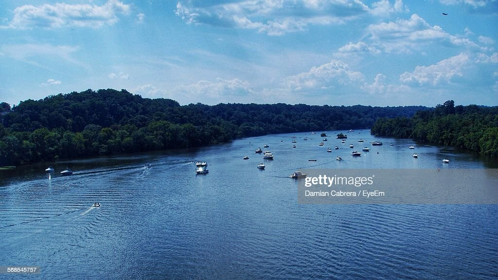 Aerial View Of Boats Sailing In River Amidst Forest Against Blue Sky : Stock Photo