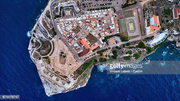 aerial view of bonifacio surrounded by sea - corsica photos et images de collection