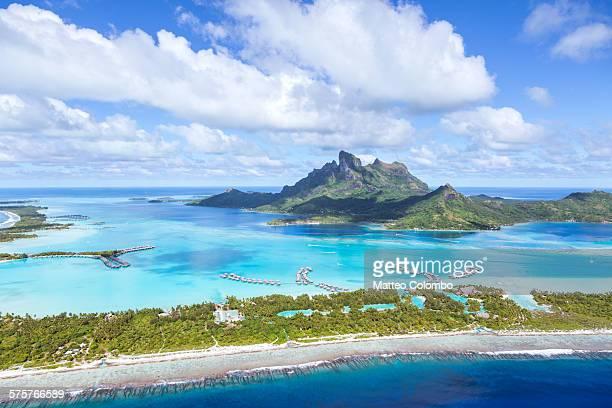 aerial view of bora bora island, french polynesia - french polynesia stock pictures, royalty-free photos & images