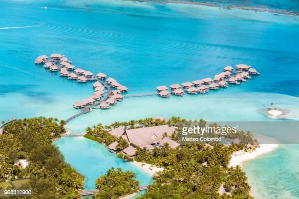 aerial view of overwater bungalows, bora bora, french polynesia - bora bora photos et images de collection