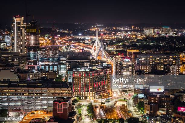 aerial view of boston cityscape at night - massachusetts stock pictures, royalty-free photos & images