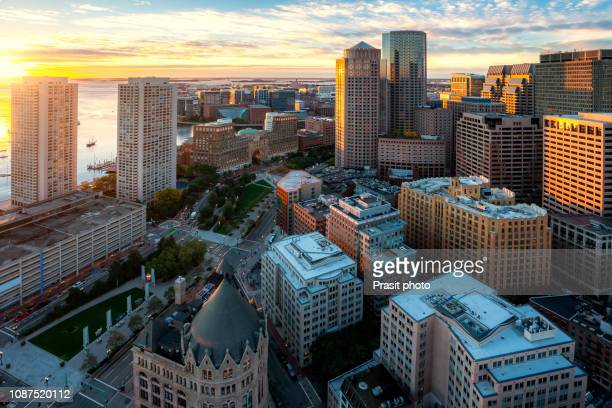 aerial view of boston harbor and financial district at sunset in boston, massachusetts, usa. - マサチューセッツ州 ボストン ストックフォトと画像
