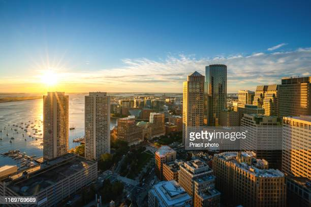 aerial view of boston harbor and financial district at sunset in boston, massachusetts, usa. - boston massachusetts stock pictures, royalty-free photos & images