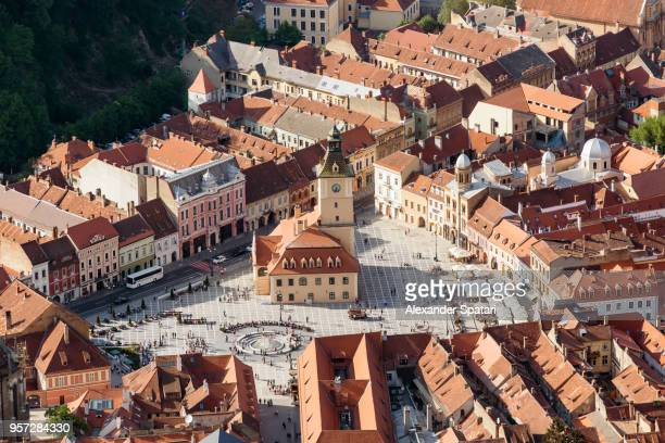 aerial view of brasov main square - piata sfatului, transylvamia, romania - romania stock pictures, royalty-free photos & images