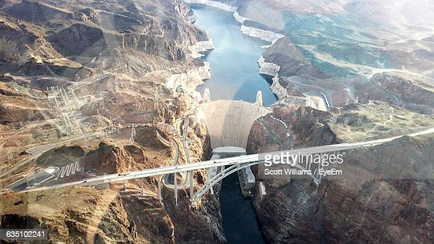 aerial view of bridge and hoover dam over colorado river - hoover dam stock photos and pictures