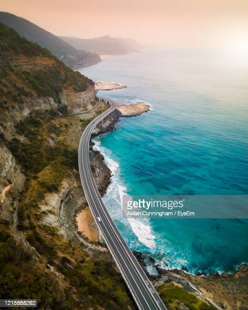 aerial view of bridge by sea - new south wales stock pictures, royalty-free photos & images