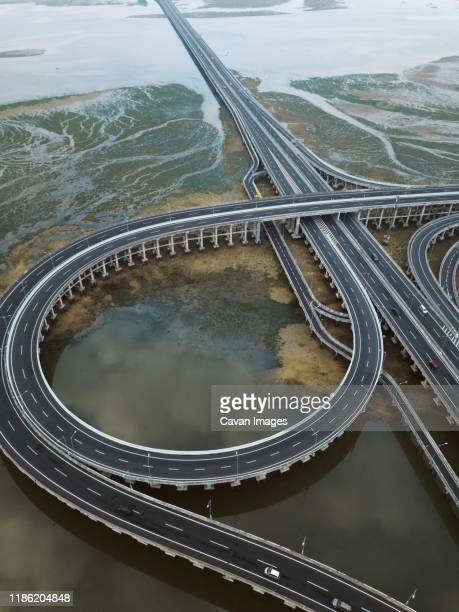 aerial view of bridge in the sea - road junction stock pictures, royalty-free photos & images