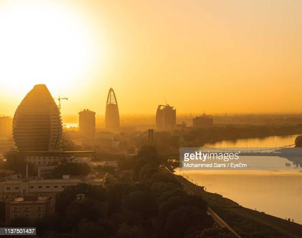 aerial view of bridge over river against orange sky during sunset - sudan stock pictures, royalty-free photos & images