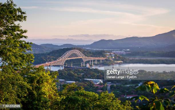 aerial view of bridge over river against sky during sunset - panama stock pictures, royalty-free photos & images