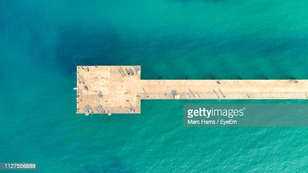 aerial view of bridge over sea - hermosa beach stock pictures, royalty-free photos & images