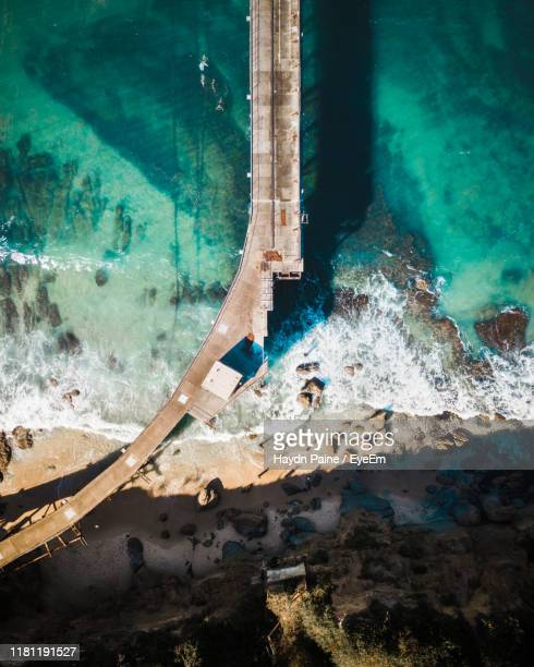 aerial view of bridge over sea - newcastle new south wales stock pictures, royalty-free photos & images