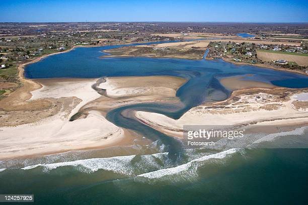 Aerial view of Bridgehampton, New York with shoal and inlet.