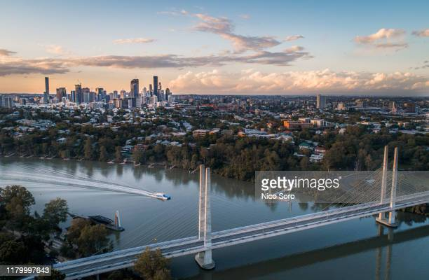 aerial view of brisbane from st lucia suburb at sunset - brisbane stock pictures, royalty-free photos & images