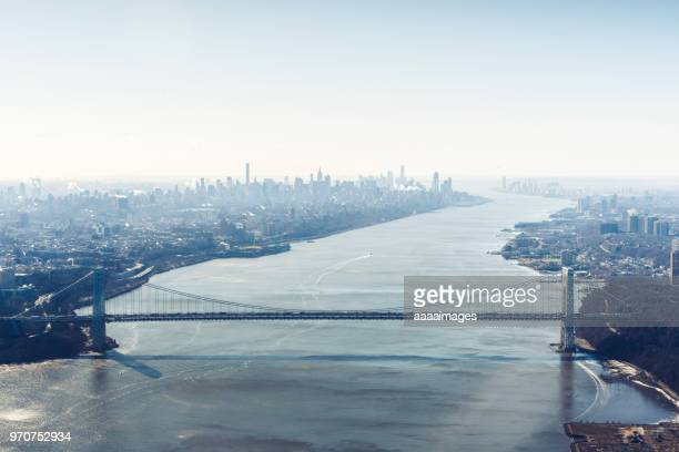 aerial view of brooklyn bridge over hudson river - hudson river stock pictures, royalty-free photos & images