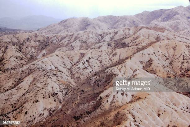 Aerial view of brown shrubspecked mountains South Korea April 1952