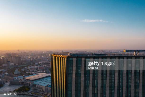aerial view of building rooftop - liyao xie stock pictures, royalty-free photos & images