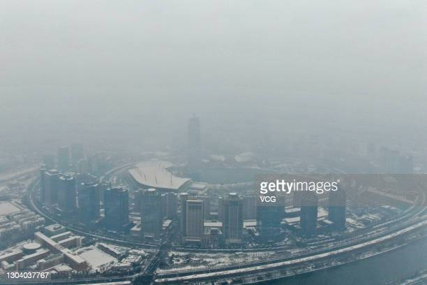 Aerial view of buildings after a snowfall on February 25, 2021 in Zhengzhou, Henan Province of China.