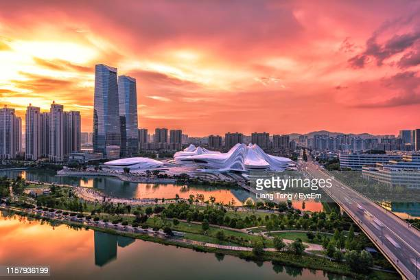 aerial view of buildings against cloudy sky during sunset - changsha stock pictures, royalty-free photos & images