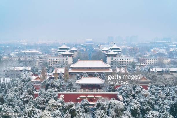 aerial view of buildings against sky during winter - beijing stock pictures, royalty-free photos & images