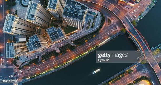 aerial view of buildings along the river - urban sprawl stock pictures, royalty-free photos & images