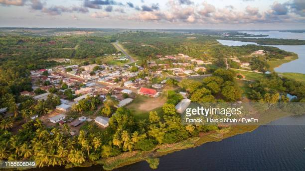 aerial view of buildings and trees - côte d'ivoire stock pictures, royalty-free photos & images
