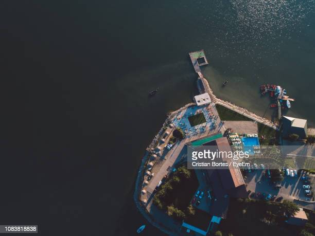 aerial view of buildings by sea - bortes stockfoto's en -beelden
