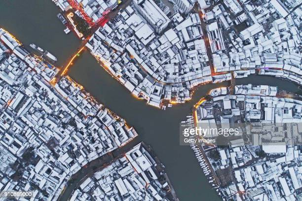 Aerial view of buildings covered in snow after being hit by a rare case of heavy snowfall at Zhujiajiao Town on January 26 2018 in Shanghai China