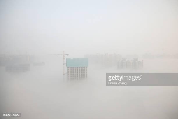 Aerial view of buildings engulfed in heavy fog on November 26, 2018 in Changzhou, Jiangsu Province, China.